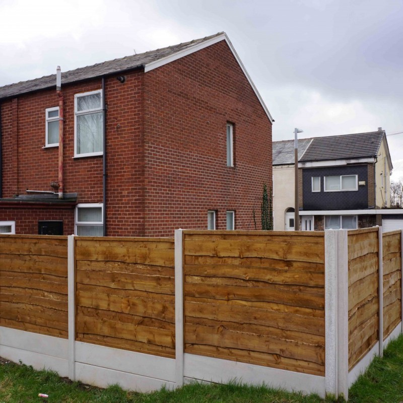 Retention of garden fence and change of use of vacant land