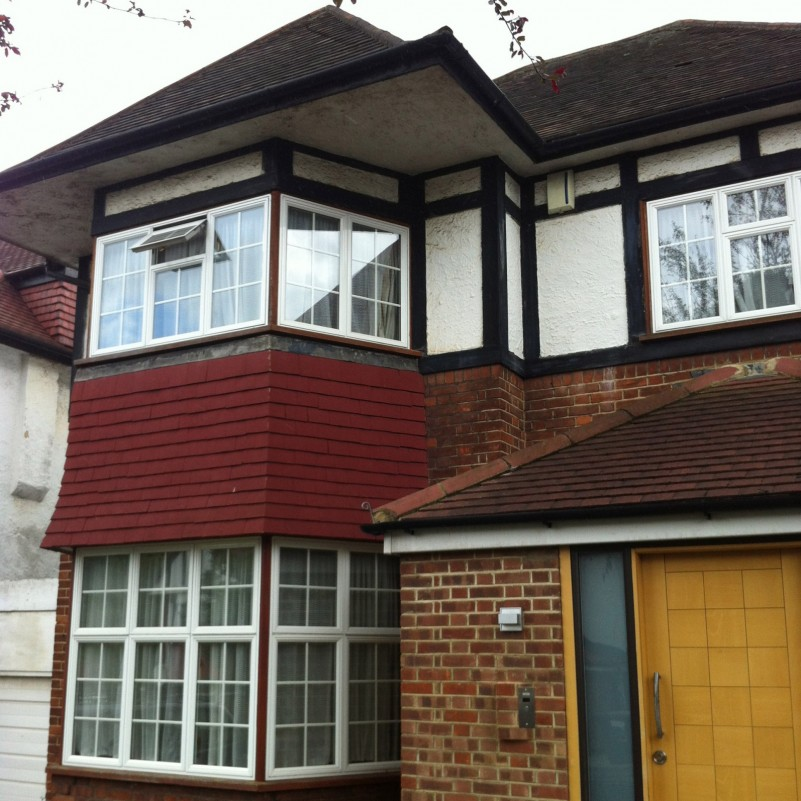 Roof extension with a rear wraparound dormer window and rooflights