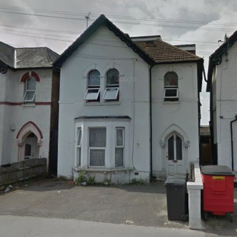 Conversion to form 2 two bedroom and 1 one bedroom flats and erection of single storey rear extension; provision of associated off-street parking; provision of associated cycle and refuse storage