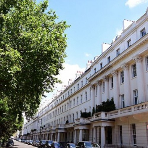 Foreign investors snap up more than half the properties in London's most prized postcodes as prices slump.