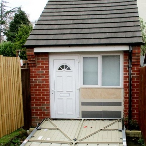 Couple who illegally converted their garage into an extra house