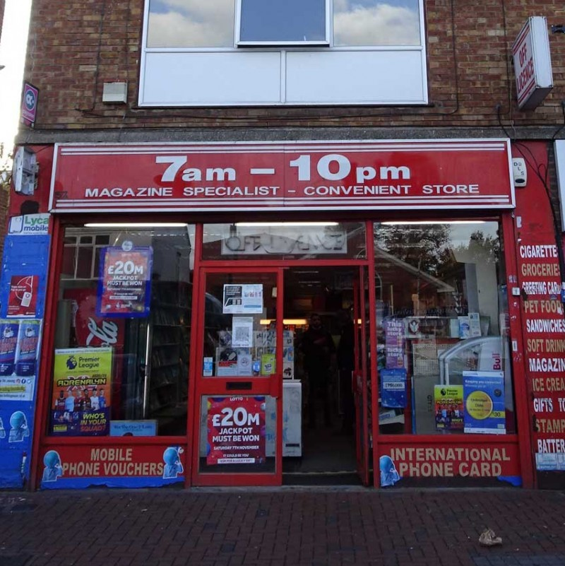 Shopfront display signs over front and a rear extraction flue