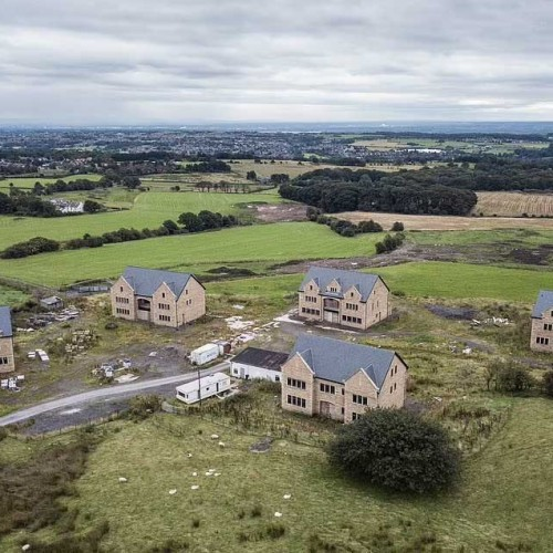 Five brand new £1million luxury mansions will be torn down.