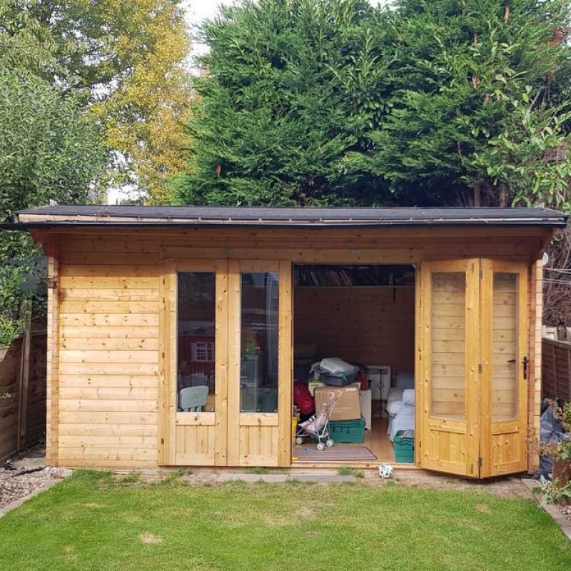 Retrospective approval for erection of replacement rear outbuilding ancillary to main dwelling